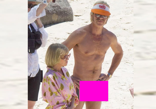 El actor Guy Pearce, erecto al lado de Kylie Minogue
