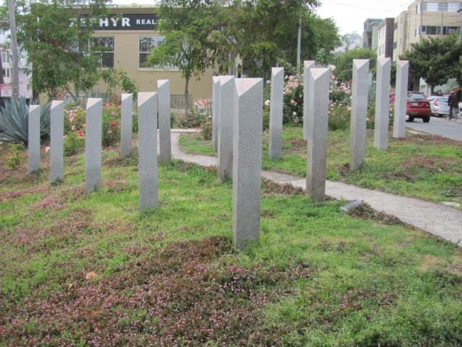 An image of Pink Triangle Park, showing how the pink triangle has been reclaimed on Holocaust Memorial Day