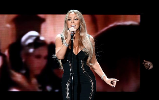 Mariah Carey, adored by many gay men, performs onstage during the AHF World AIDS DAY Concert.