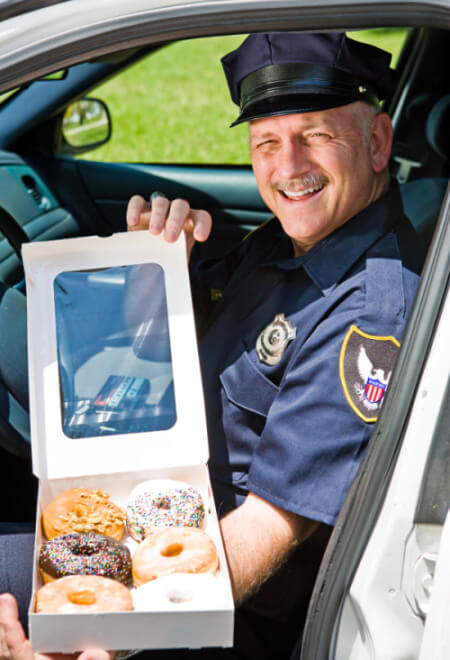 police officer cop with donuts