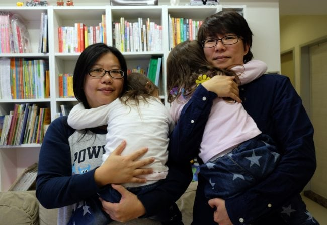 Same-sex couples such as Hope Chen (L), 37, and Zoro Wen, 34, raise children who perform better at school, a study indicated.