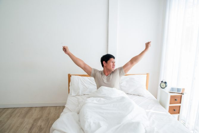 Man waking up alone