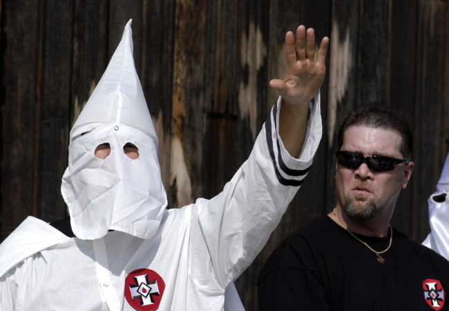 A Ku Klux Klan member, just like the ones West Virginia Republican lawmaker Eric Porterfield compared the LGBT+ community to, salutes during an American Nazi Party rally at Valley Forge National Park September 25, 2004 in Valley Forge, Pennsylvania