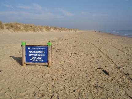 Gay nude beaches: Naturist sign on nudist beach in Bournemouth
