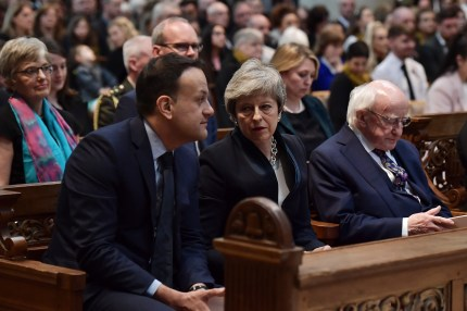 Leo Varadkar, Theresa May and Michael D Higgins sit together in St Anne's Cathedral.