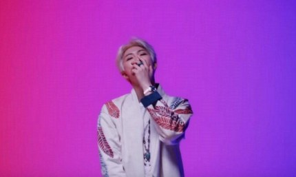 "Bisexual flag colours—pink, purple and blue—decorate the video for ""Persona"" by BTS rapper Kim Namjoon, known as RM."
