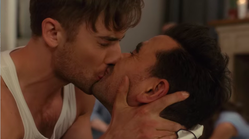 Dan Levy and actor kiss